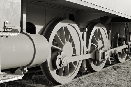 black and white railroad tracks: Detail of an old steam locomotive at the port of Magdeburg