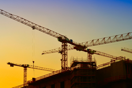 cranes on the construction site of the City Palace in Berlin Standard-Bild
