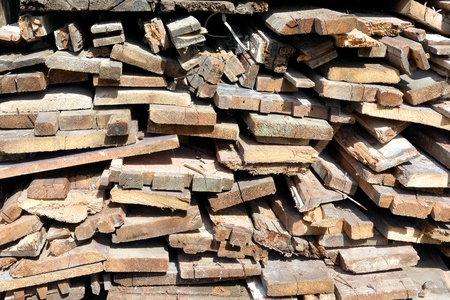house demolition: Stack firewood from a house demolition in front of a house Stock Photo