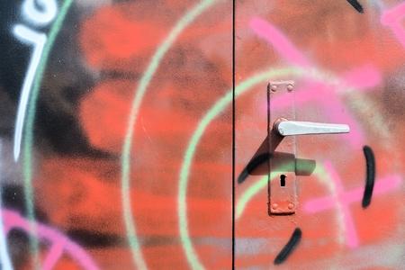 daubed: Graffiti on a closed steel door
