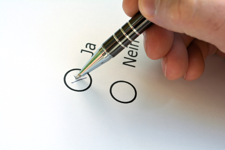 Vote on yes or no on a ballot Stock Photo