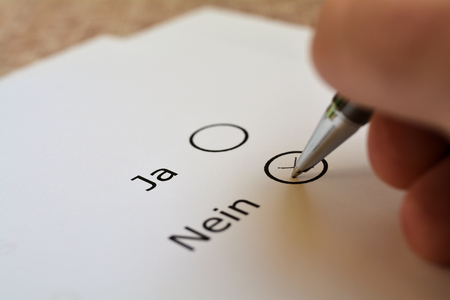 questionary: Vote on yes or no on a ballot Stock Photo