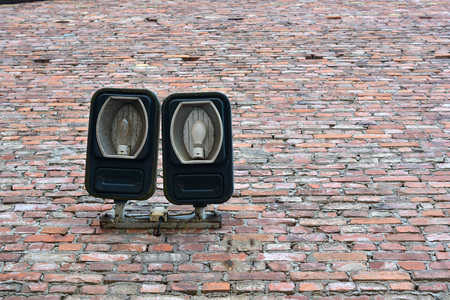 abandoned warehouse: old lamps on the facade of an abandoned warehouse