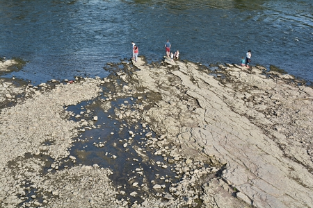 riverbed: Magdeburg, Germany - August 1, 2015: People in the dry riverbed of the Elbe near Magdeburg Editorial