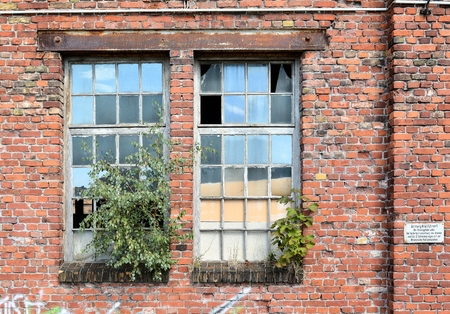 industrial wasteland: facade of an abandoned abandoned factory