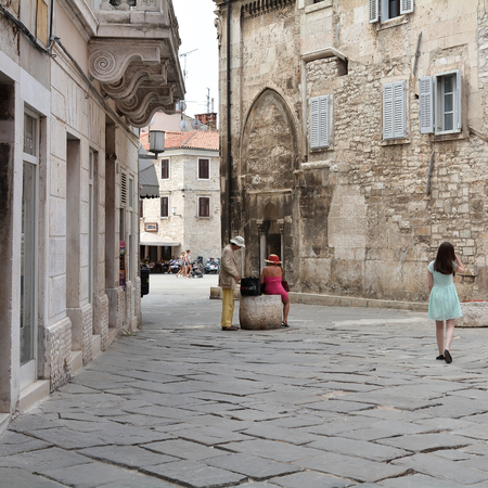 sightseers: PULA, CROATIA - JULY 13, 2015: tourists in the historic city of Pula in Croatia