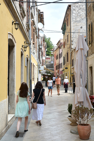 sightseers: PULA, CROATIA - JULY 13, 2015: Tourists in old town of Pula in Croatia