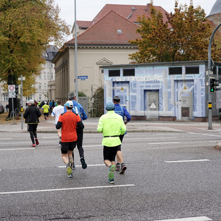 exertion: Magdeburg, Germany - OCTOBER 18, 2015: Athletes at the 12th Magdeburg Marathon in downtown Magdeburg