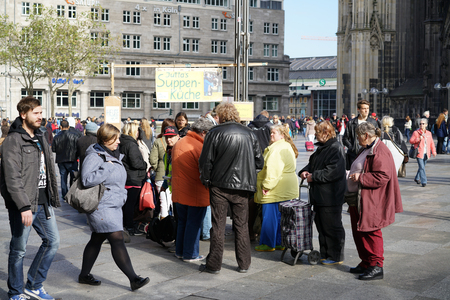 food distribution: COLOGNE, GERMANY - OCTOBER 23, 2015: distribution of food to the homeless in the center of Cologne
