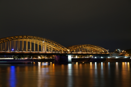 fluent: The Hohenzollern Bridge in Cologne in the evening