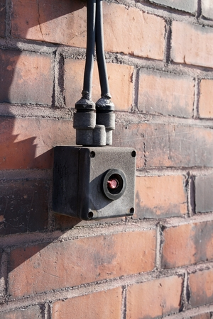 industrial wasteland: emergency switch on the facade of a warehouse in the port of Magdeburg Stock Photo