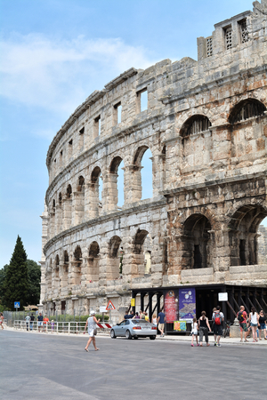 sightseers: PULA, CROATIA - JULY 13, 2015: Tourists at the Arena in Pula, The Landmark of the city