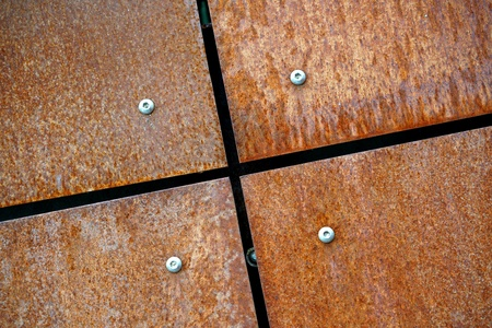 corroding: rusty metal plates as facade design Stock Photo