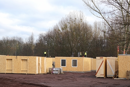 prefabricated house: Magdeburg, Germany - November 27, 2015: Construction of a refugee camp on the outskirts of Magdeburg