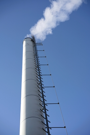 particulate: smoking chimney at a boiler house