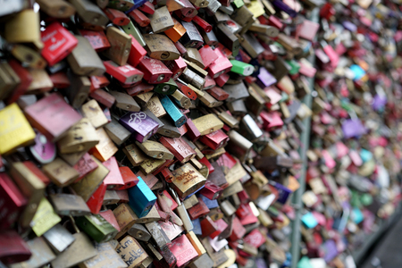inseparable: COLOGNE, GERMANY - OCTOBER 20, 2015: Padlocks of loving couples on the Hohenzollern Bridge in Cologne Editorial