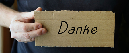 obliged: sign made of cardboard with the words Thank you