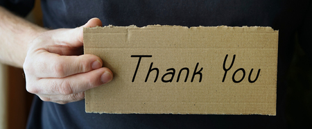 sign made of cardboard with the words Thank you