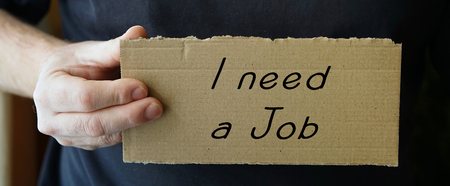 joblessness: sign made of cardboard with the words I need a job