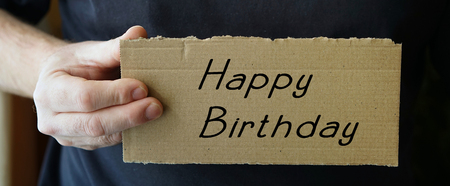 obliged: sign made of cardboard with the words Happy Birthday