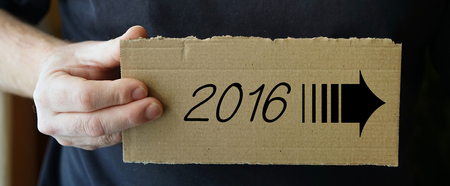 time specification: sign made of cardboard with the 2016