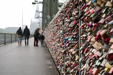 inseparable: Padlocks of loving couples on the Hohenzollern Bridge in Cologne Stock Photo