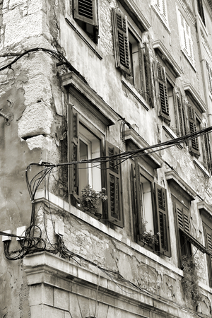 deprecated: old house in the historic center of Pula in Croatia