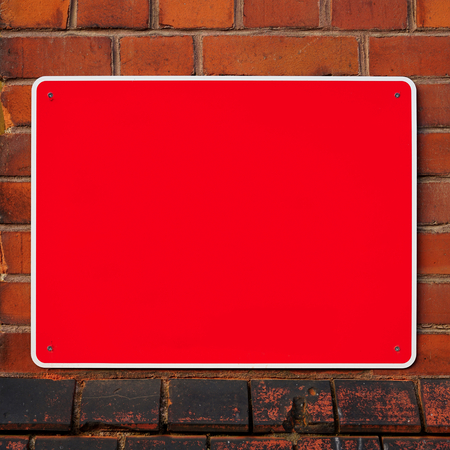 unlabelled: Empty red sign on the facade of a house Stock Photo