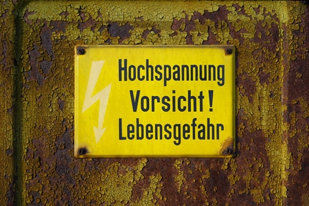 mortal danger: yellow warning label did says high voltage Caution mortal danger