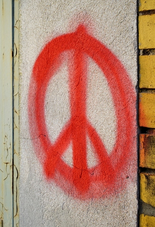 simbolo della pace: Peace symbol on the facade of a house in Magdeburg
