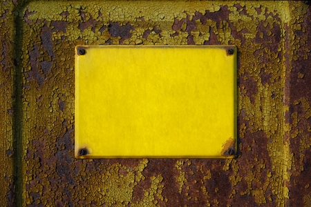 unlabelled: empty yellow sign on the facade of a house Stock Photo