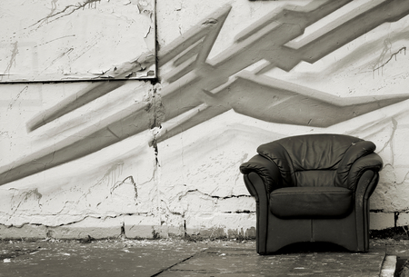 disposed: old chair in of an abandoned factory site Stock Photo