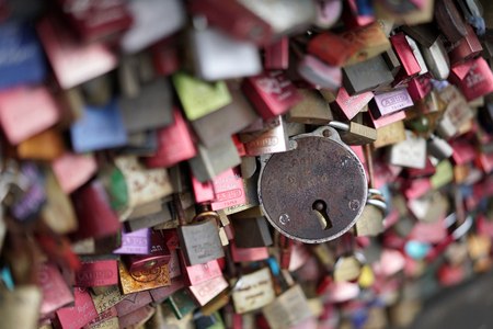 inseparable: COLOGNE, GERMANY - OCTOBER 20, 2015: Padlocks of loving couples as a sign of loyalty on the Hohenzollern Bridge in Cologne Editorial