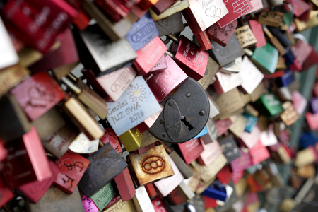 inseparable: COLOGNE, GERMANY - OCTOBER 21, 2015: Padlocks of loving couples as a sign of loyalty on the Hohenzollern Bridge in Cologne