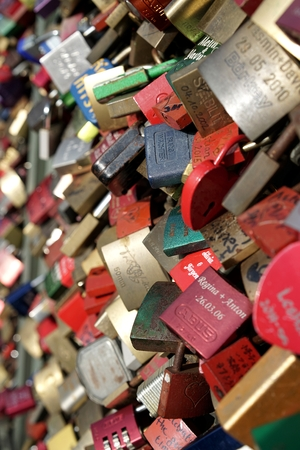 pledge of allegiance: COLOGNE, GERMANY - OCTOBER 23, 2015: Padlocks of loving couples as a sign of loyalty on the Hohenzollern Bridge in Cologne Editorial