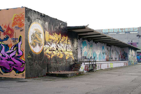 industrial wasteland: Magdeburg, Germany - DECEMBER 30, 2015: Graffiti on the premises of aerosol Arena, a former factory site in Magdeburg, left graffiti sprayers Which what Editorial