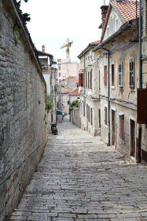 sightseers: PULA, CROATIA - JULY 13.2015: Alley in the old town of Pula in Croatia Editorial