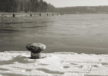 coldness: bollard at the sluice in Niegripp in winter