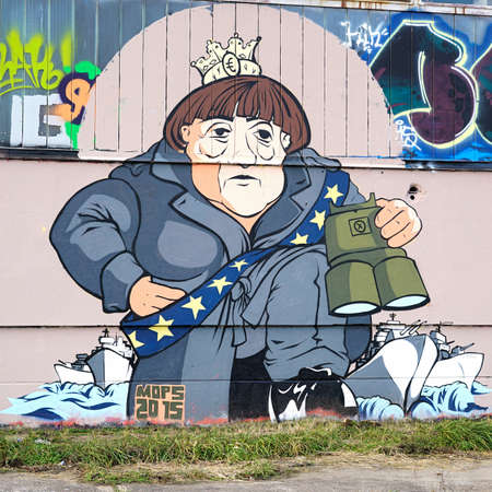 industrial wasteland: Magdeburg, Germany - DECEMBER 30, 2015: Graffiti from Chancellor Angela Merkel on the premises of aerosol-Arena in Magdeburg. The graffiti which taken during the event Meeting of Styles in September 2015