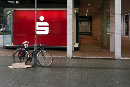 bank branch: HANOVER, GERMANY - FEBRUARY 01, 2016: bicycle in front of at savings bank branch named Sparkasse Hannover Editorial