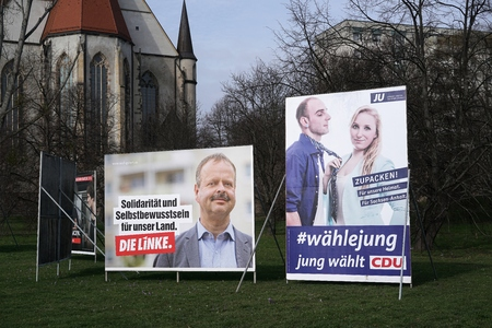state election: MAGDEBURG, GERMANY - FEBRUARY 19, 2016: campaign placards of Several parties for the state election in Saxony-Anhalt on 13 March 2016 the city of Magdeburg in Germany