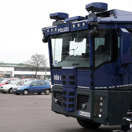 police state: MAGDEBURG, GERMANY - MARCH 05, 2016: increased police presence with water cannon during the football game against 1.FC Magdeburg FC Hansa Rostock before the stadium in Magdeburg