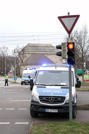 police state: MAGDEBURG, GERMANY - MARCH 05, 2016: roadblock by the police after a football match of 1.FC Magdeburg against FC Hansa Rostock in Magdeburg