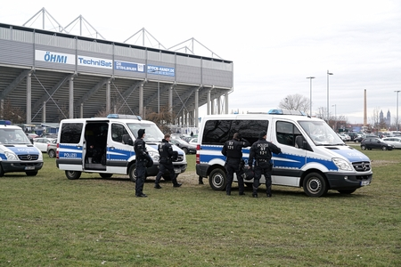 presence: MAGDEBURG, GERMANY - MARCH 05, 2016: Police presence during the football game against 1.FC Magdeburg FC Hansa Rostock in Magdeburg