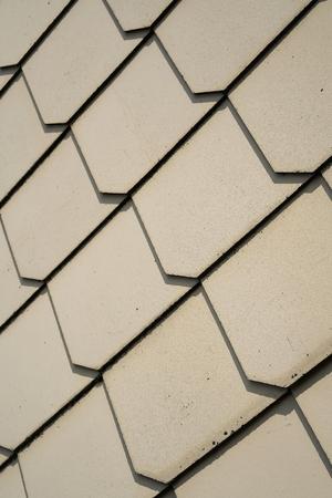 cladding: shingles as wall cladding on the facade of a house Stock Photo