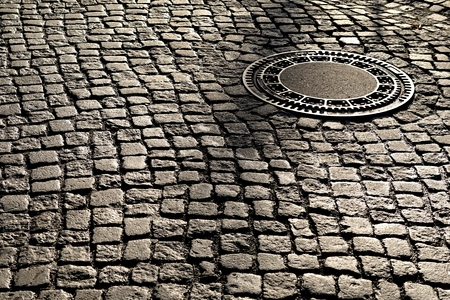 manhole cover: manhole cover on an old street in Magdeburg Stock Photo