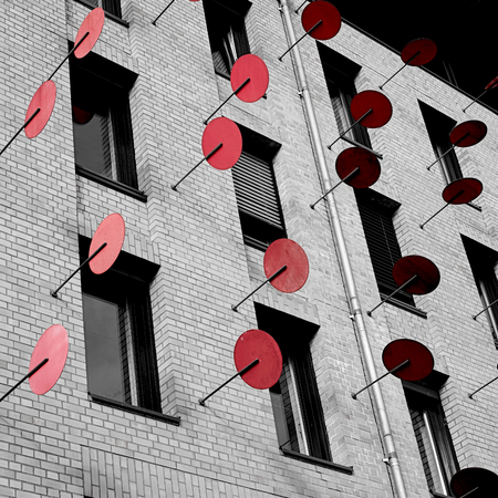 discs: red metal discs as artwork on the regional tax office Magdeburg Stock Photo