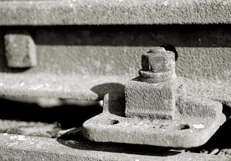 industrially: old rusty screw on a railway track