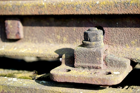 railway track: old rusty screw on a railway track