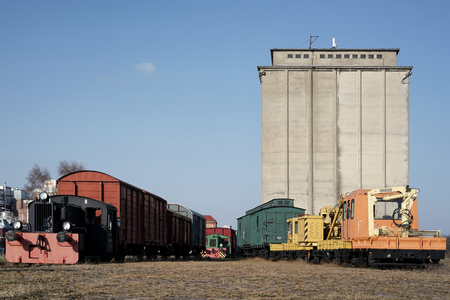 industrially: old locomotives and railway carriages on the siding